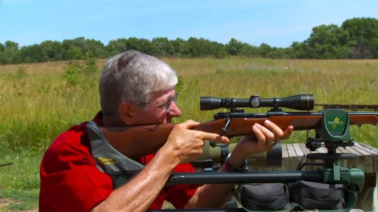 How do you sight in a rifle scope?